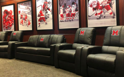 "Since the dedication of the Steve ""Coach"" Cady Arena at the Goggin Ice Center in 2006, Miami University Ice Hockey has completed renovations within the Weight and Conditioning Room, Champions Room and Legacy Hallway. This new facility that opened in 2014 has been a celebration of the program's history and key tool in recruiting. Their players lounge, while modern and new, was need of new and additional seating. Looking for something durable, that could withstand years of use while delivering comfort and honoring their brand, they turned to DreamSeat for a tailored solution."